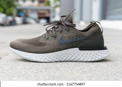 BANGKOK , THAILAND - AUGUST 5, 2018 : Product shoot of Nike men's running shoe, Nike Epic React Flyknit on stone cement floor