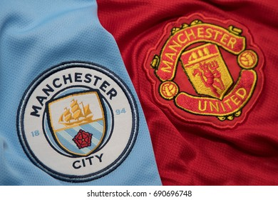 BANGKOK, THAILAND - AUGUST 5: Logo of Manchester City andManchester United  Football Club on the Jersey on August 5,2017 in Bangkok Thailand.