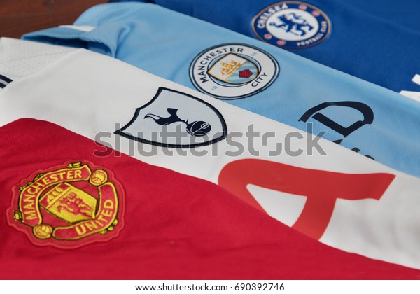 BANGKOK, THAILAND - AUGUST 5: The Logo of  Manchester United, Tottenham Hotspur , Manchester City and Chelsea on Football Jerseys on August 5 ,2017  in Bangkok Thailand.