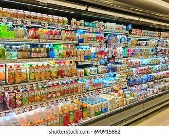 Bangkok, Thailand - August 6, 2017: Shelf of consumer goods, products, orange, mango, mangosteen, grape juice, milk, yogurt at Tops market. Tops market is a big supermarket in Thailand.