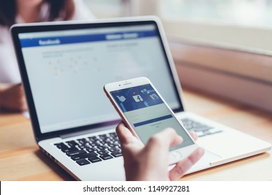 Bangkok, Thailand - August 6, 2018 : hand is pressing the Facebook screen on apple iphone 6 ,Social media are using for information sharing and networking.