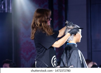 """Bangkok, Thailand - August 6, 2019 ; Master show Hair trend in """"Schwarkopf Essential Look 2019"""", Runway present Newest Trend of Hair style color and cut on stage at St. Regis Hotel"""