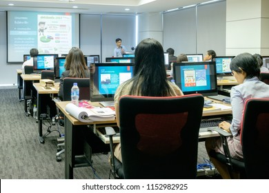 BANGKOK, THAILAND - August 6: The Excise Department on August 6,2018 in Bangkok, Thailand. Instructor teaching how to use Graphic Design Software to Students at Computer room.