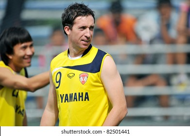 BANGKOK THAILAND- AUGUST 6 :Robbie Fowler of MTUTD during in Thai Premier League (TPL) between Muangthong United and Thai Port Fc at PAT Stadium on August 6,2011 in  Bangkok Thailand