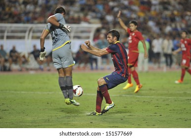 BANGKOK, THAILAND - AUGUST 7: Cesc Fabregas(L2) of FC Barcelona in action during the international friendly match Thailand XI and FC Barcelona at Rajamangala Stadium on August7,2013 in,Thailand.