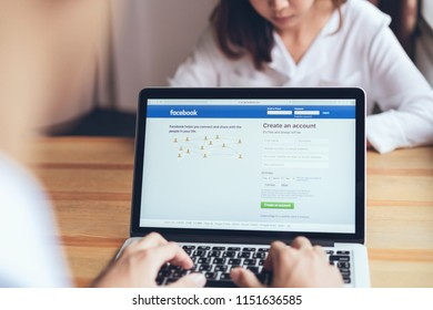 Bangkok, Thailand - August 8, 2018 : Women use login screen Facebook icons on apple macbook pro. largest and most popular social networking site in the world.