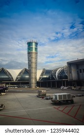 Bangkok, Thailand - August 9, 2017: Airplane control tower and the terminal building with blue sky background at Suvarnabhumi International Airport, Thailand.