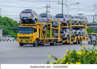 Bangkok, Thailand - August,5,2018: Car transporter truck running on the road, on August,5,2018 in Bangkok, Thailand