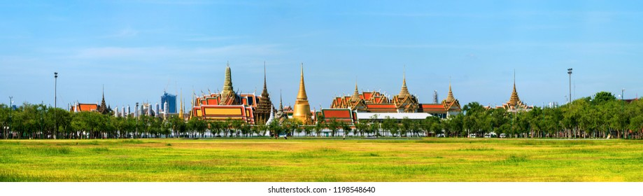 Bangkok, Thailand. Car and people traffic in the center of Bangkok, Thailand with Wat Arun temple of the dawn at the background. Sunny day