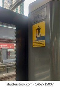 Bangkok, Thailand - Circa July 2019 : BTS sky railway warning sign on side door, Do not lean against platform screen doors.