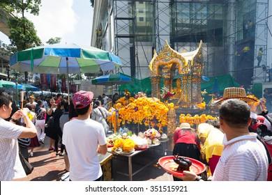 BANGKOK, THAILAND - CIRCA OCTOBER, 2015: People paying respect to the Erawan Shrine, a Hindu shrine housing a statue of Phra Phrom, after the Bangkok bomb attack, CIRCA OCTOBER, 2015 - BANGKOK