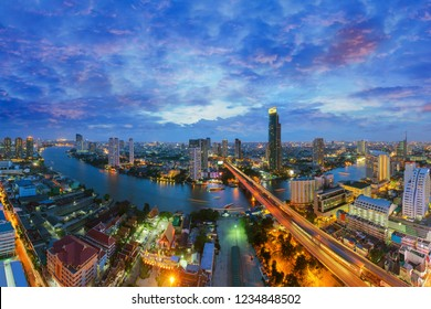 Bangkok , Thailand city skyline. Landscape of building at Bangkok central business around the Chao Phraya river. Aerial view of Thailand modern building in business district area at twilight.