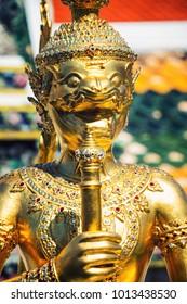 Bangkok, Thailand. Close view of religious sculpture of the Temple of the Emerald Buddha in popular landmark of Bangkok, Thailand