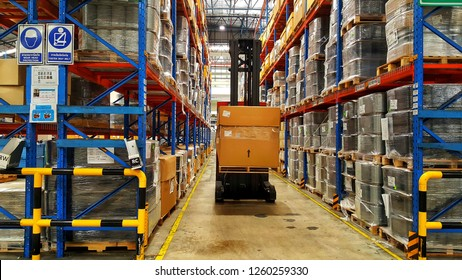 Bangkok, THAILAND Dec 04, 2018:  The forklift driver lifts up the goods on a shelf in Warehouse.