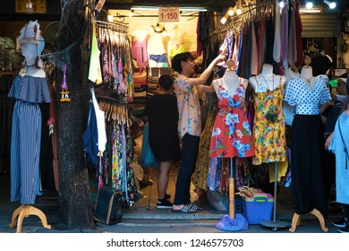 BANGKOK, THAILAND - DEC 1 : Tourists are shopping clothes and fashion products at Chatuchak Market on December 1, 2018 in Bangkok, Thailand. Chatuchak Market is the largest weekend market in Thailand.