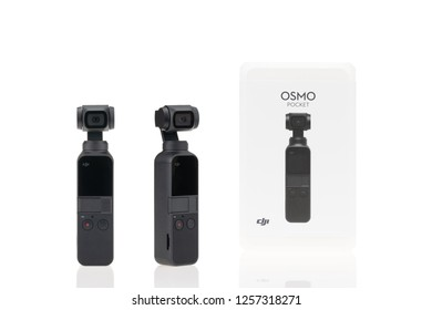 Bangkok, Thailand - Dec 12, 2018: Studio shot of brand new DJI Osmo Pocket gimbal camera and product package box, front and side view, isolate on white background. Illustrative editorial content
