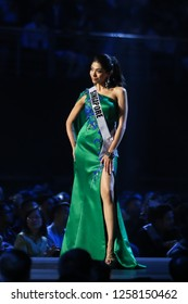 Bangkok, Thailand - Dec 13, 2018: Zahra Khanum of Singapore competes in the evening gown competition during the Miss Universe 2018 preliminary round, the final to be held on Dec 17.