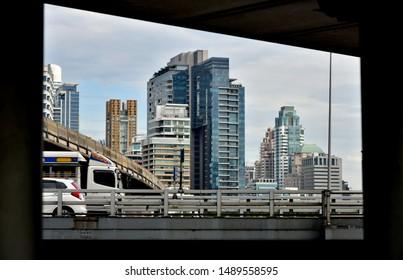 BANGKOK, THAILAND - DEC 16 : Bangkok cityscape with bridge foreground on 16 December 2018 in Bangkok, Thailand