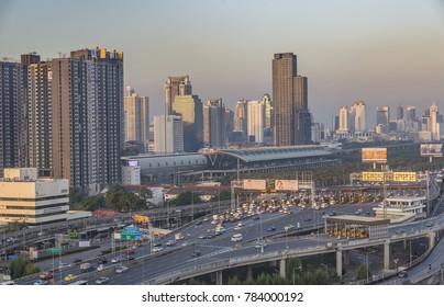 Bangkok, Thailand - Dec 17, 2017 Morning of express way. City syscape as backdrop. Many cars on express way.