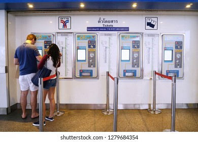 Bangkok, Thailand - Dec, 2018: Passenger and traveler purchasing train tickets from vending machine at BTS sky train station in Bangkok, Thailand.