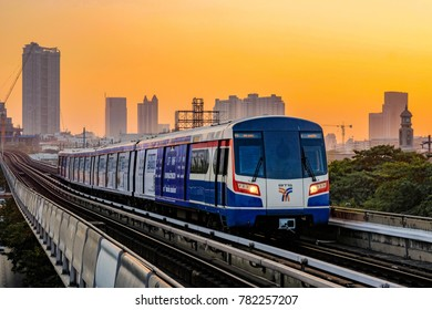 Bangkok, Thailand - DEC 25, 2017: Bangkok BTS Sky Train Approaching in the Terminal Station at Sunset Time with Buildings Around.