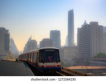 Bangkok, THAILAND - DEC 27: BTS Skytrain with the city in the midst of the fog. The Bangkok Mass Transit System, commonly known as the BTS.