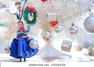 Bangkok, Thailand - Dec 5, 2018 : A photo of Anna, character from Frozen movie (2013) , is decorating the Christmas tree. Anna is Princess Elsa's little sister.