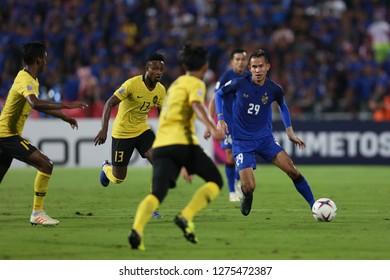 BANGKOK THAILAND DEC 5:Sanrawat Dechmitr of Thailand in action during the AFF SUZUKI CUP 2018 FINAL ROUNDS Match Thailand and Malaysia at Rajamangala Stadium on December 5,2018 in Thailand.
