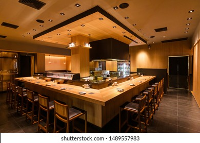 BANGKOK, THAILAND. DEC 8, 2016:  Yakitori Japanese Grilled Skewer Restaurant with counter bar around the grill kitchen area. Mostly decorated with oak wood texture.