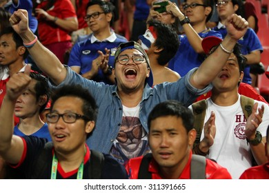 BANGKOK THAILAND DEC17::Unidentified fans of Thailand supporters during the AFF Suzuki Cup 2014 Match between Thailand and Malaysia at Rajamangala Stadium on December 17,2014 in Thailand.