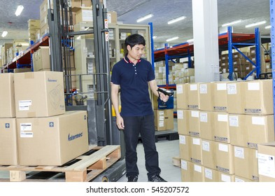 Bangkok , Thailand - December 01 ,2016 : Worker with portable barcode scanner in warehouse at Oga International company. Scan Product of Intermec
