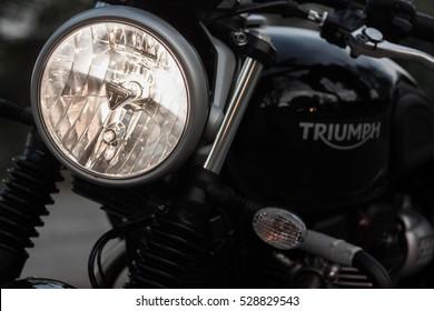 Bangkok, Thailand - December 04, 2016: Close up Headlight Triumph street twin motorcycle modern classic motorcycle model 2016. High performance retro style big bike motorcycle.