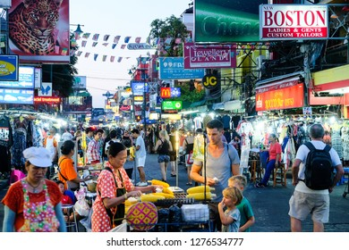 Bangkok, Thailand - December 06, 2018: Tourists and locals walking along the busy streets of Khao San Road in Bangkok. Khao San Road is a world famous backpacker street.
