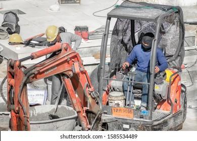 BANGKOK, THAILAND - DECEMBER 08: Unidentified construction worker operates an old Kubota excavator in Bangkok on December 08, 2019.