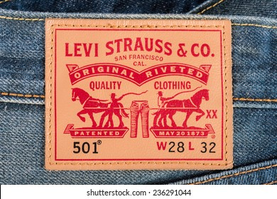 BANGKOK, THAILAND - DECEMBER 09 2014: Close up of the LEVI'S leather label on the blue jeans. LEVI'S is a brand name of Levi Strauss and Co, founded in 1853.