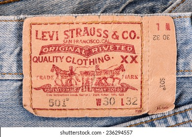 BANGKOK, THAILAND - DECEMBER 09 2014: Close up of the LEVI'S leather label on the old blue jeans. LEVI'S is a brand name of Levi Strauss and Co, founded in 1853.