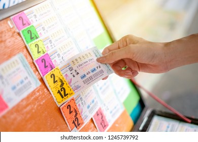 BANGKOK, THAILAND - December 1: Ladprao Intersection road on December 1,2018 in Bangkok, Thailand. Woman hand holding Thai lottery ready for sale in the market.