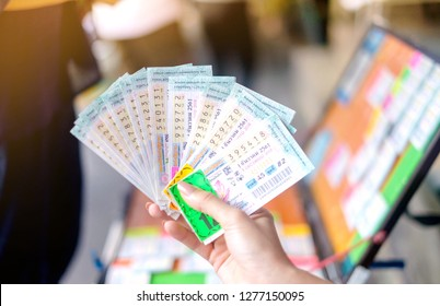 BANGKOK, THAILAND - December 1: Ladprao Intersection road on December 1,2018 in Bangkok, Thailand. Woman hand holding Thai lottery ready for sale in the market