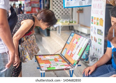 BANGKOK, THAILAND - December 1: Ladprao Intersection road on December 1,2018 in Bangkok, Thailand. People looking Thai lottery with seller for buying at the market