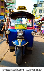 Bangkok, Thailand - December 10, 2012: Colorful Tuk-Tuk taxi vehicle parked in the Khao-San road area, famous part of Bangkok