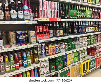 Bangkok, Thailand - December 10, 2017 : Selected focus. Shelf of beverage, domestic and imported beer cans and bottles at Tops supermarket. Tops supermarket is a big supermarket in Thailand