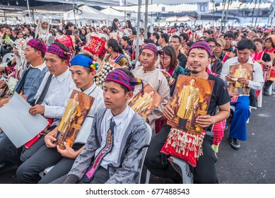 Bangkok, Thailand. December 12,2016 : Thai hill tribe people holding king bhumibol(Rama 9) at  royal field for pay respect to the king  funeral ceremony in Bangkok of Thailand.