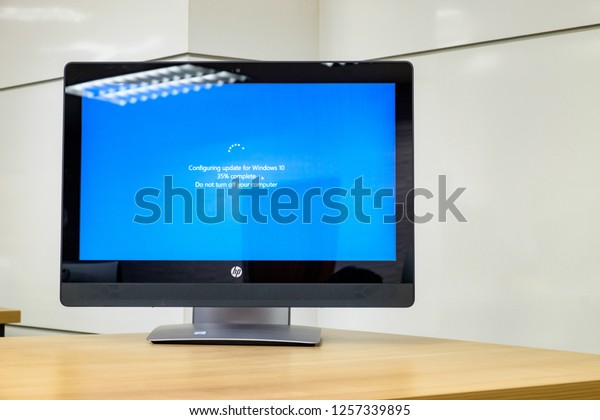 BANGKOK, THAILAND - December 13: Computer Room Excise Department on December 13,2018 in Bangkok, Thailand. Monitor computer showing its screen with Microsoft Windows 10 update for fix bugs.