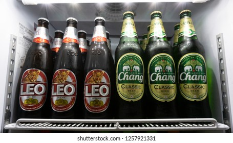 BANGKOK, THAILAND -December 14, 2018: Bottles Beer Chang and Leo lined up in the refrigerator, supermarket shelf  - Image