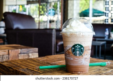 BANGKOK, THAILAND - December 15, 2014: Glass of Starbuck Coffee Frappuccino Blended Beverages. Starbucks is the world's largest coffee house with over 20,000 stores in 61 countries.