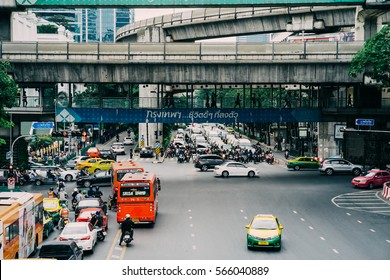 Bangkok, Thailand - December 15, 2016: Cars, buses, taxis and Motorcycle at Ratchaprasong Intersection in Bangkok in the morning.