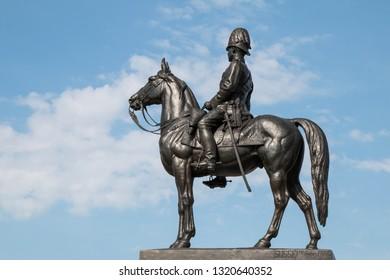 BANGKOK, THAILAND - December 15, 2018 : The equestrian statue of King Chulalongkorn (Rama V) with blue sky.