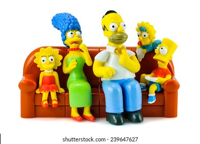Bangkok, Thailand - December 16, 2014: Simpsons family on sofa and see the scary movie figure toy character. There are plastic toy sold as part of the Burger King toys.