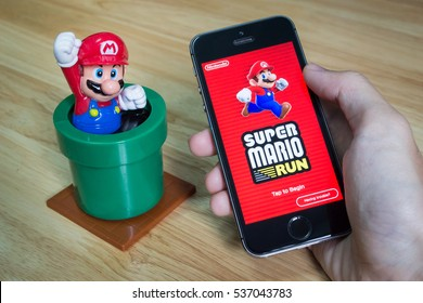 Bangkok, Thailand - December 16, 2016 : Apple iPhone5s held in one hand showing its screen with Super Mario Run application.