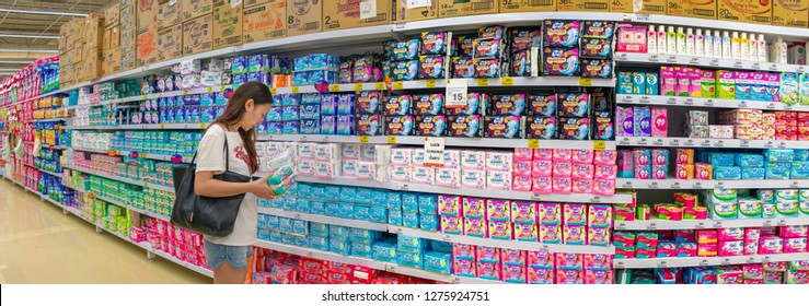 BANGKOK, THAILAND - DECEMBER 16: Unidentified female customer shops for feminine hygiene products on the shelves of BigC Extra Petchkasem hypermarket in Bangkok on December 16, 2018.